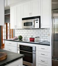 Stainless Steel Kitchen Cabinets with Black Subway Tile ...