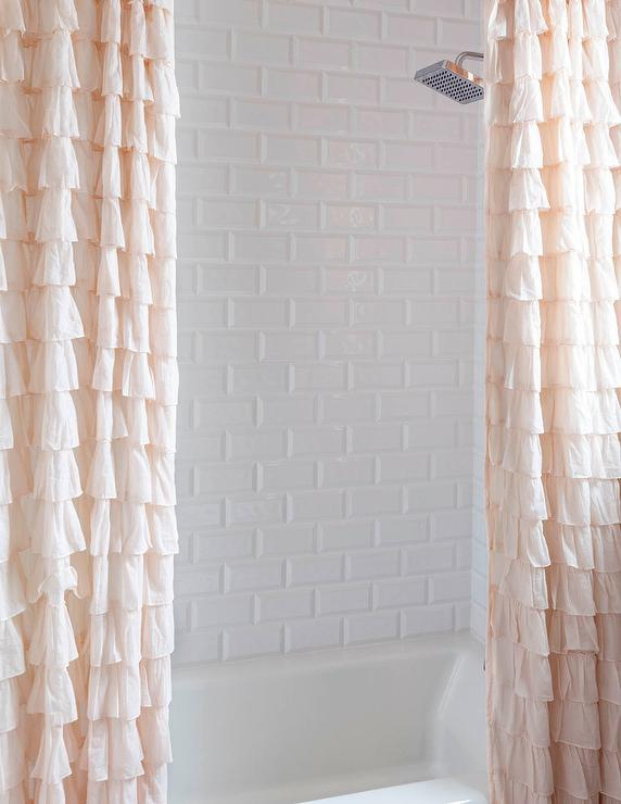 two pink ruffled shower curtains