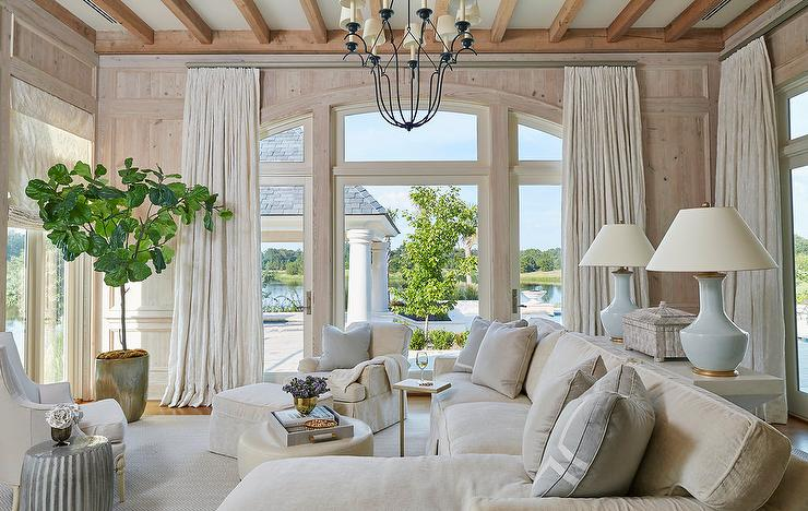 white sofa living room mantle no fireplace and tan with blue accents transitional