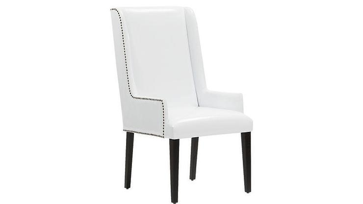 white leather wingback chair suede dining table chairs reynolds patent