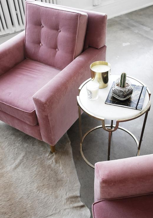 Pink Velvet Tufted Chairs with Taupe Cowhide Rug