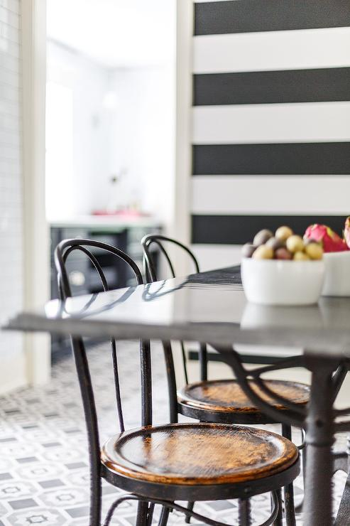 bistro chairs dining room best bean bag 2018 black and white design ideas contemporary boasts cafe placed in front of a rectangular french table complemented by striped walls