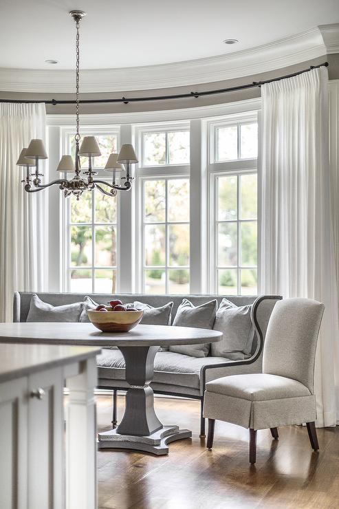 Curved Gray Dining Settee in Bay Window  Transitional