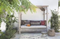 Mediterranean Style Backyard with Outdoor Canopy Daybed