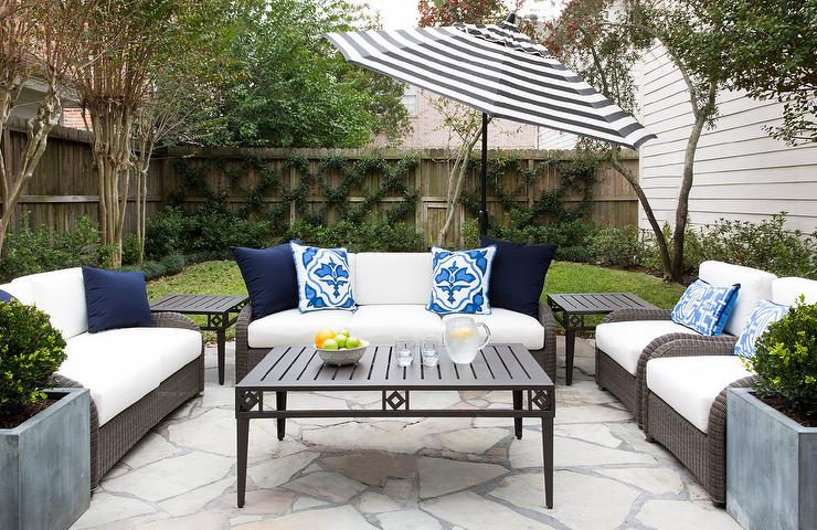 gray wicker outdoor sofa with black and