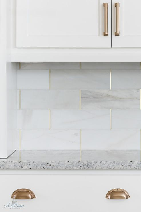 honed white tiles with gold trim