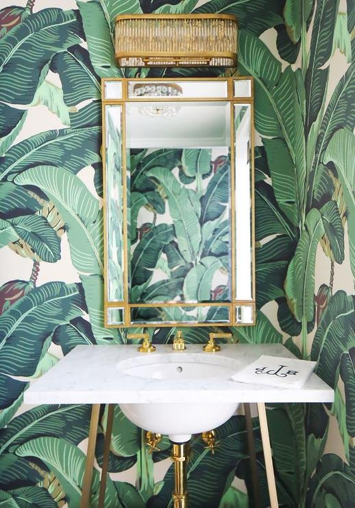White and Gold Powder Room with Martinique Banana Leaf Wallpaper  Transitional  Bathroom