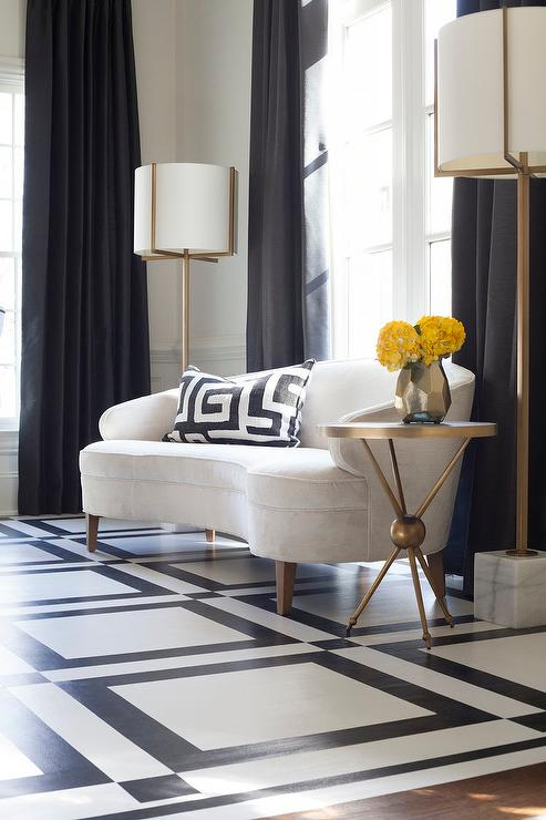 White Curved Sofa with Brass and Marble Floor Lamps