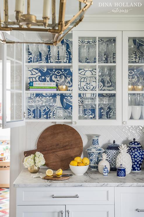 Blue Wallpaper on Back of Glass KItchen Cabinets