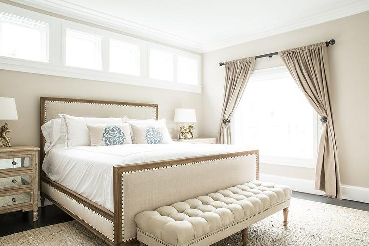 Wood and Linen Upholstered Bed with Damask Pillows