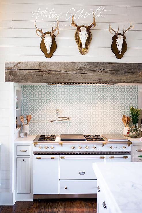 ashley furniture kitchen tables sink types antlers on hood - cottage