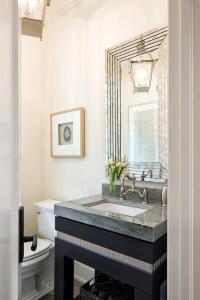Black Sink Vanity with Art Deco Mirror