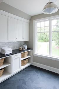 White Laundry Cabinets with Gray Slate Herringbone Floor ...