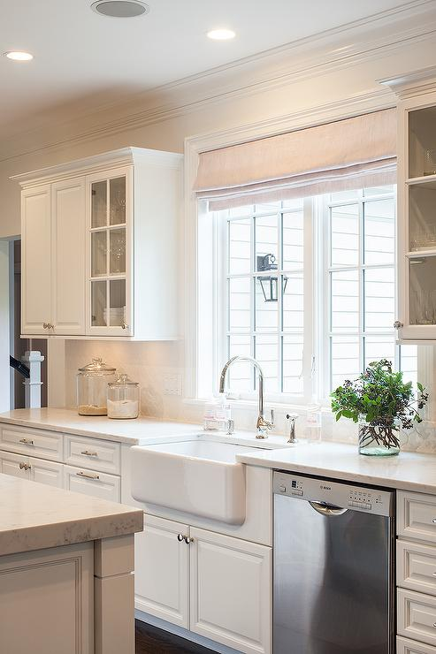 kitchen windows counter top ideas farmhouse sink under design a and polished nickel gooseneck faucet stands two dressed in single roman shade