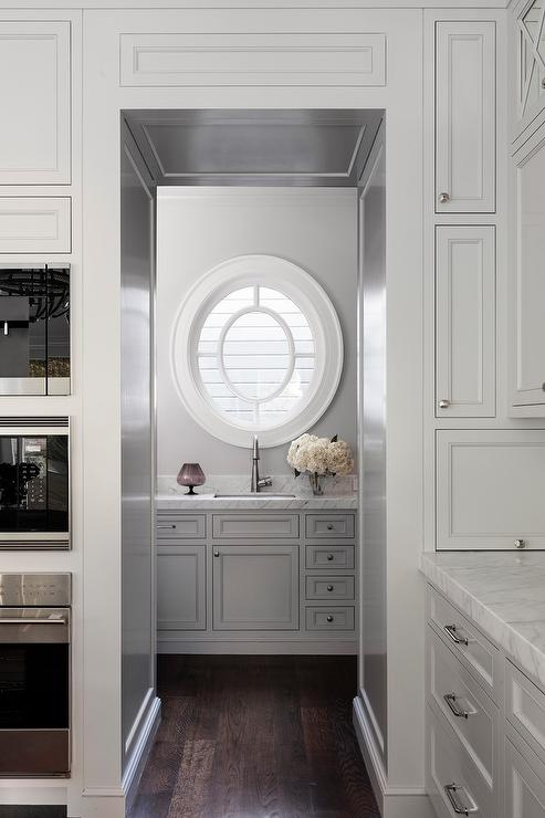 If breakfast just seems off to you when there isn't a plate of toast within close reach, you know how important a good toaster is for creating those perfectly crunchy, golden brown slices. Oval Window over Pantry Sink - Transitional - Kitchen
