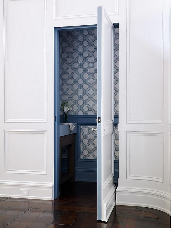 Blue Powder Room with Gold Bamboo Wall Sconces