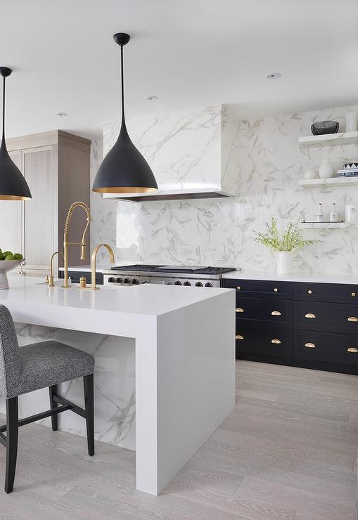 Black Lights With White Marble Waterfall Island Contemporary Kitchen