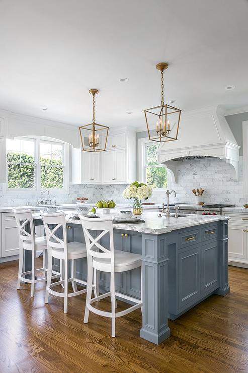 Blue Island With Mini Brass Lanterns Transitional Kitchen