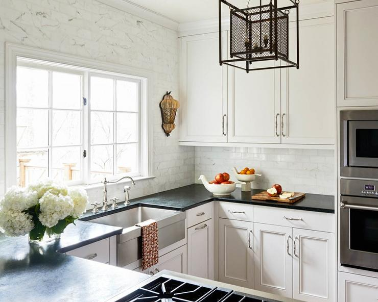 Ivory Kitchen Cabinets with Black Granite Counters and