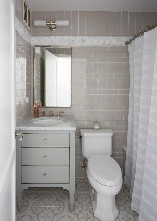 gray guest bath with gray cement tiles