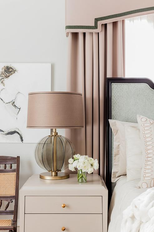 Pink Curtains Behind Gray Headboard Transitional Bedroom