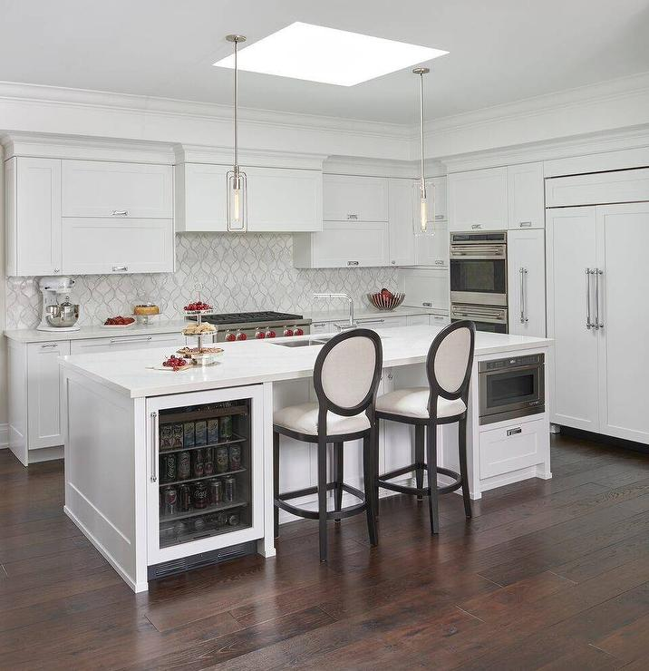 wood and stainless steel kitchen island valance square skylight over - transitional