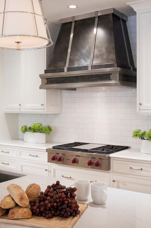 dark steel kitchen vent hood with white