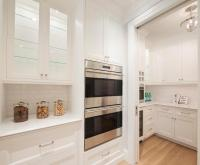 White Pantry with Pocket Door - Transitional - Kitchen