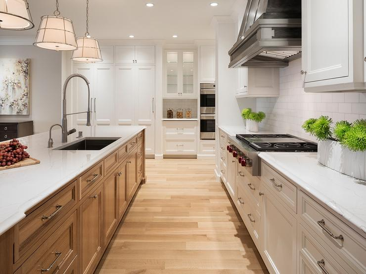 gooseneck kitchen faucet vinyl flooring black steel hood with white cabinets ...