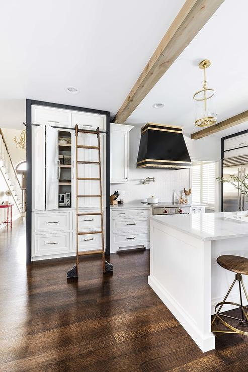 Black And White Pantry Cabinets With Ladder On Rails Transitional