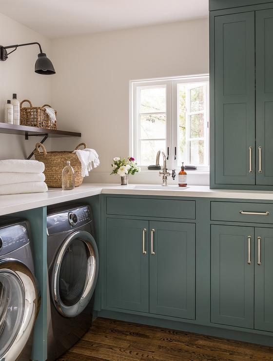 Green Laundry Room Cabinets with Whirlpool Washer and