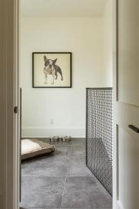 Black Metal Gate at Dog Room - Transitional - Laundry Room