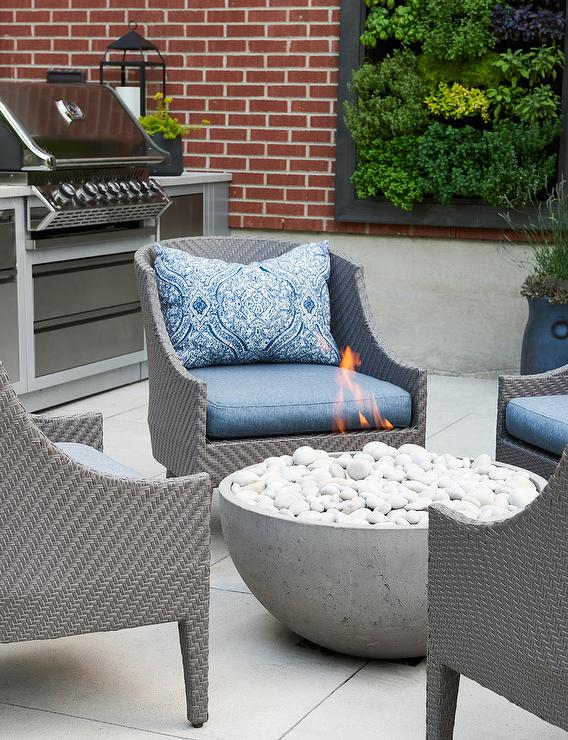 gray outdoor chairs with blue pillows