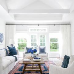 White Slipcovered Sofa Living Room Simple Designs Blue Design Ideas Well Lit Cottage Features A Matching Accent Chairs And Pillows Around Wood Trestle Coffee Table