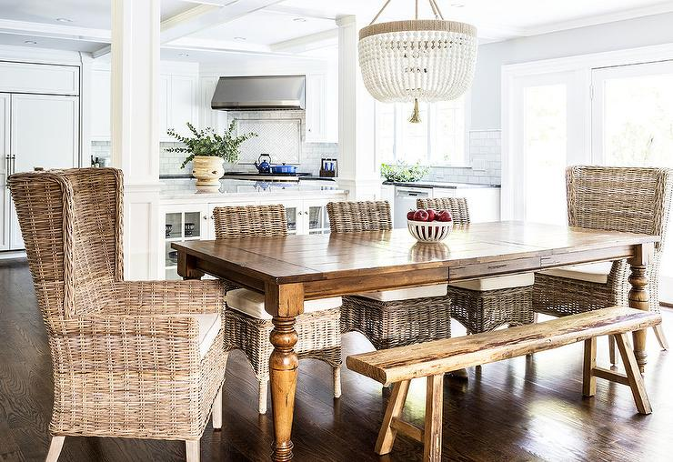white wicker chairs and table memory foam dining design ideas a ro sham beaux malibu chandelier hangs over farmhouse seating sawhorse bench side wingback head