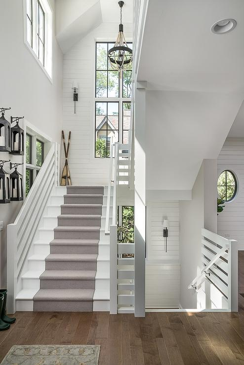 White Cottage Staircase With Lanterns Hanging On Hooks