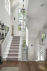 White Cottage Staircase with Lanterns Hanging on Hooks ...