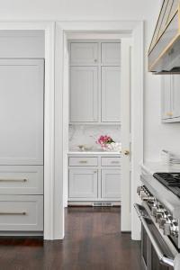 Gold Door Knob on White Pantry Pocket Door - Transitional ...