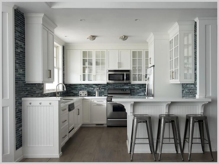 White Beadboard Cabinets with Honed Black Countertops