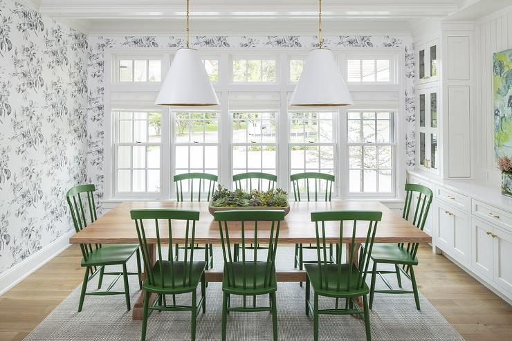 green dining room table and chairs metal patio emerald velvet with brass trim transitional two goodman hanging lamps hang above a blond wood trestle placed on plaid rug accented windsor