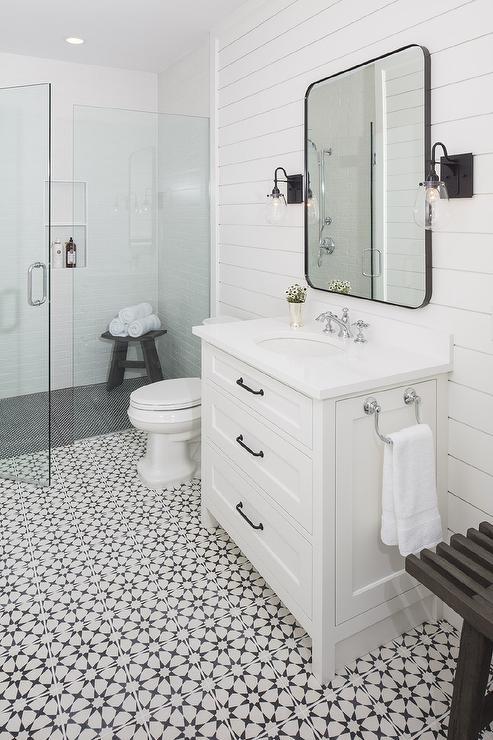 White Bath Vanity with Black Hex Tile Floor  Transitional