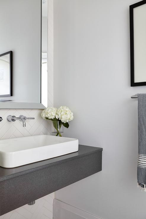 gray floating sink vanity with white