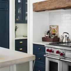 La Cornue Kitchen Pantry Cabinet For Reed Single Sconces On Gray Marble Backsplash Over Stove ...