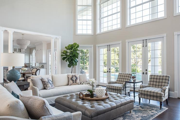 living room with sofa and two accent chairs design styles large gray leather tufted ottoman as coffee table transitional