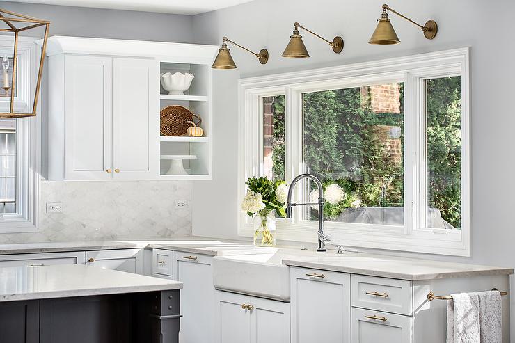 sconces above kitchen window design ideas