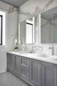 Gray Bath Vanity Cabinets with White Subway Tiles ...