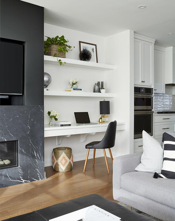 black white striped chair taupe accent three floating shelves over wall mount tv - transitional living room