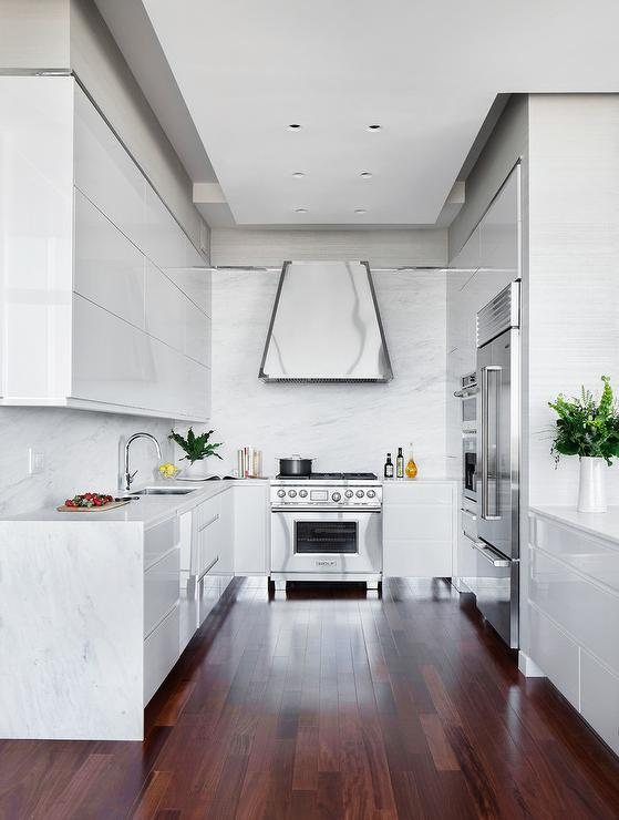 Glossy White Lacquer Cabinets With White Quartz Waterfall