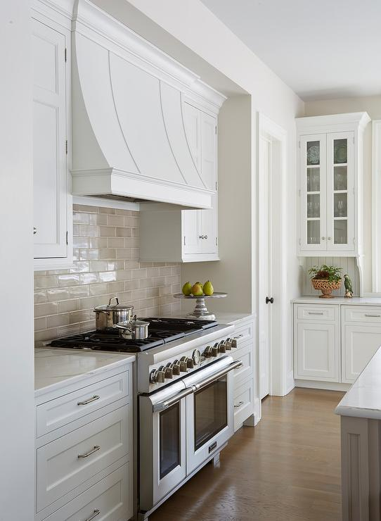 White and Taupe Kitchen with Calacatta Gold Oval Tiles