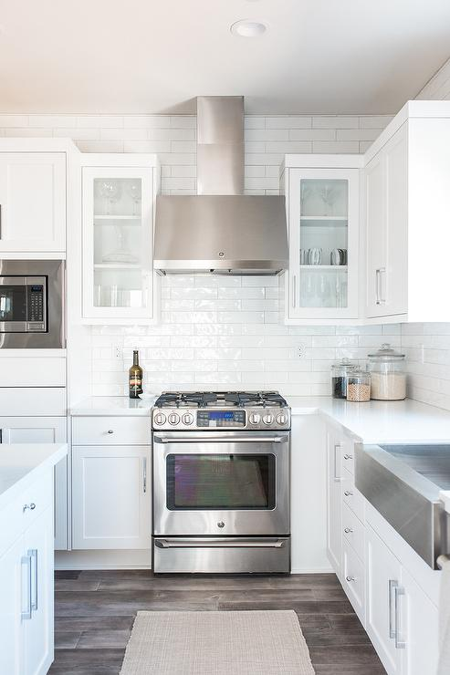 White Cabinets with Gray Stained Wood Floors